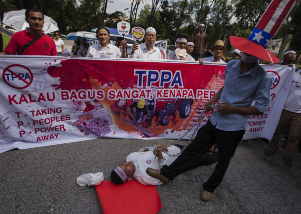 Activists during a protest against the proposed Trans-Pacific Partnership (TPP) agreement in Kuala Lumpur, Malaysia 19 July 2013. The protest is against the proposed Trans-Pacific Partnership (TPP) agreement under negotiation by the US, Australia, New Zealand, Chile, Peru, Brunei, Singapore, Vietnam, Canada, Mexico, Malaysia and Japan. EPA/AZHAR RAHIM